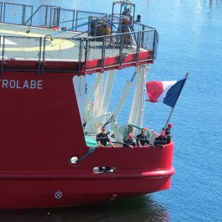 L Astrolabe and sailors on Hobart docks Credit Miranda Nieboer